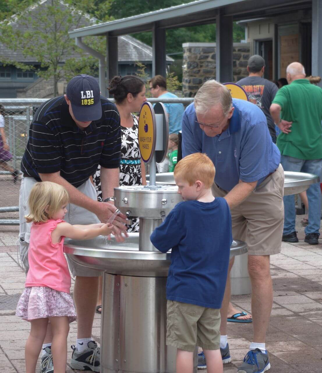 Family enjoying hand washing stations at Philadelphia Zoo KidZooU
